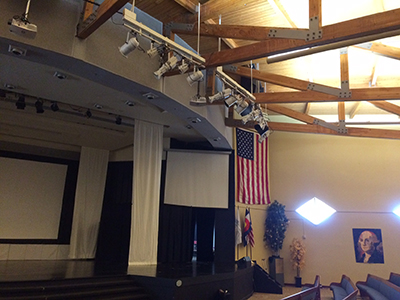 The Aspen Academy auditorium features high ceilings that made speech intelligibility and sound bleed an issue before Primacoustic acoustic panels were installed