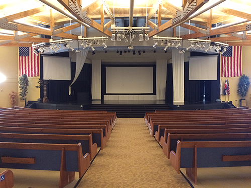 Aspen Academy auditorium view from rear showing Primacoustic Acoustic Panels installed for sound absorption.
