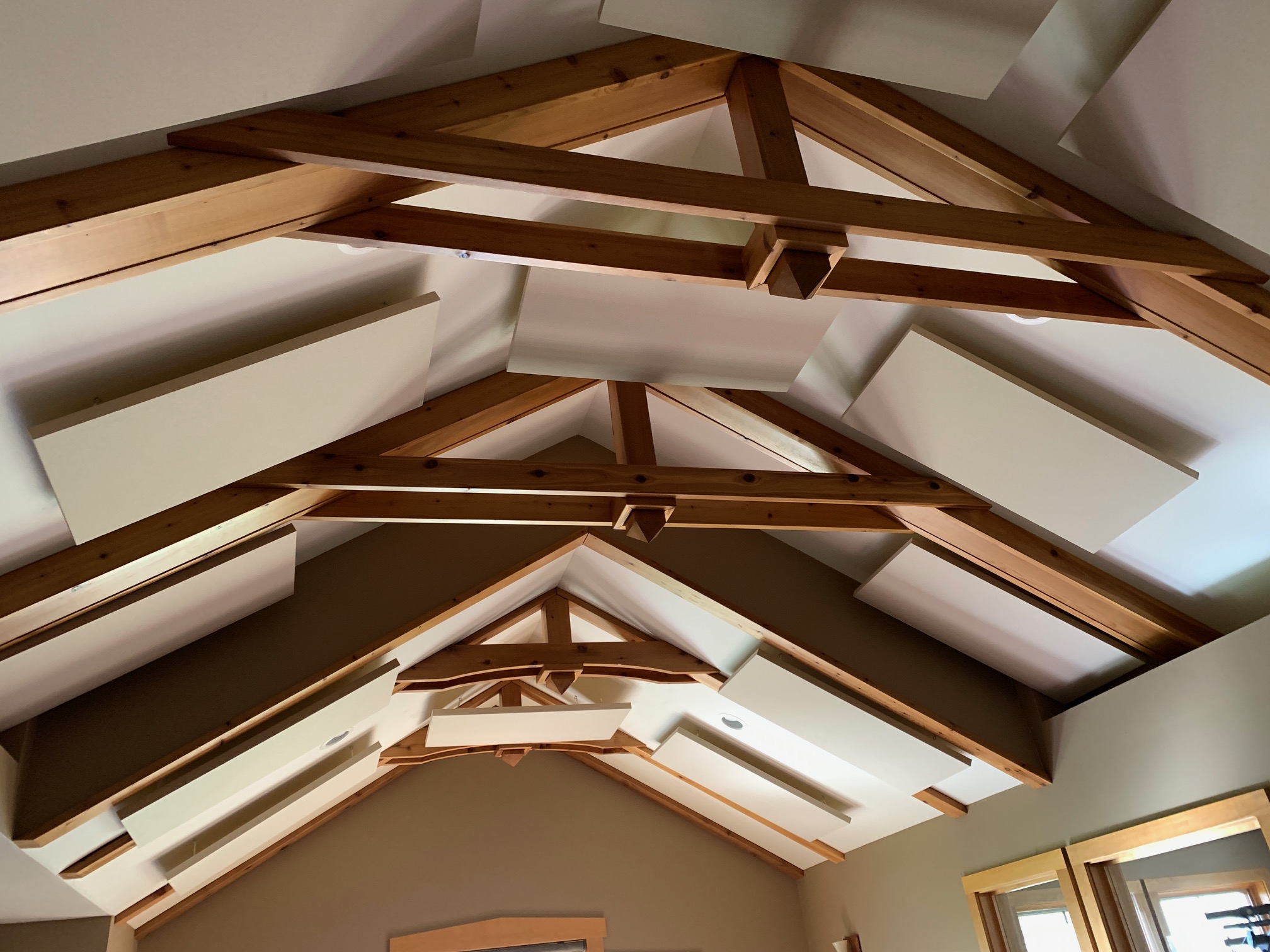 Primacoustic Nimbus acoustic ceiling clouds in a high arch ceiling